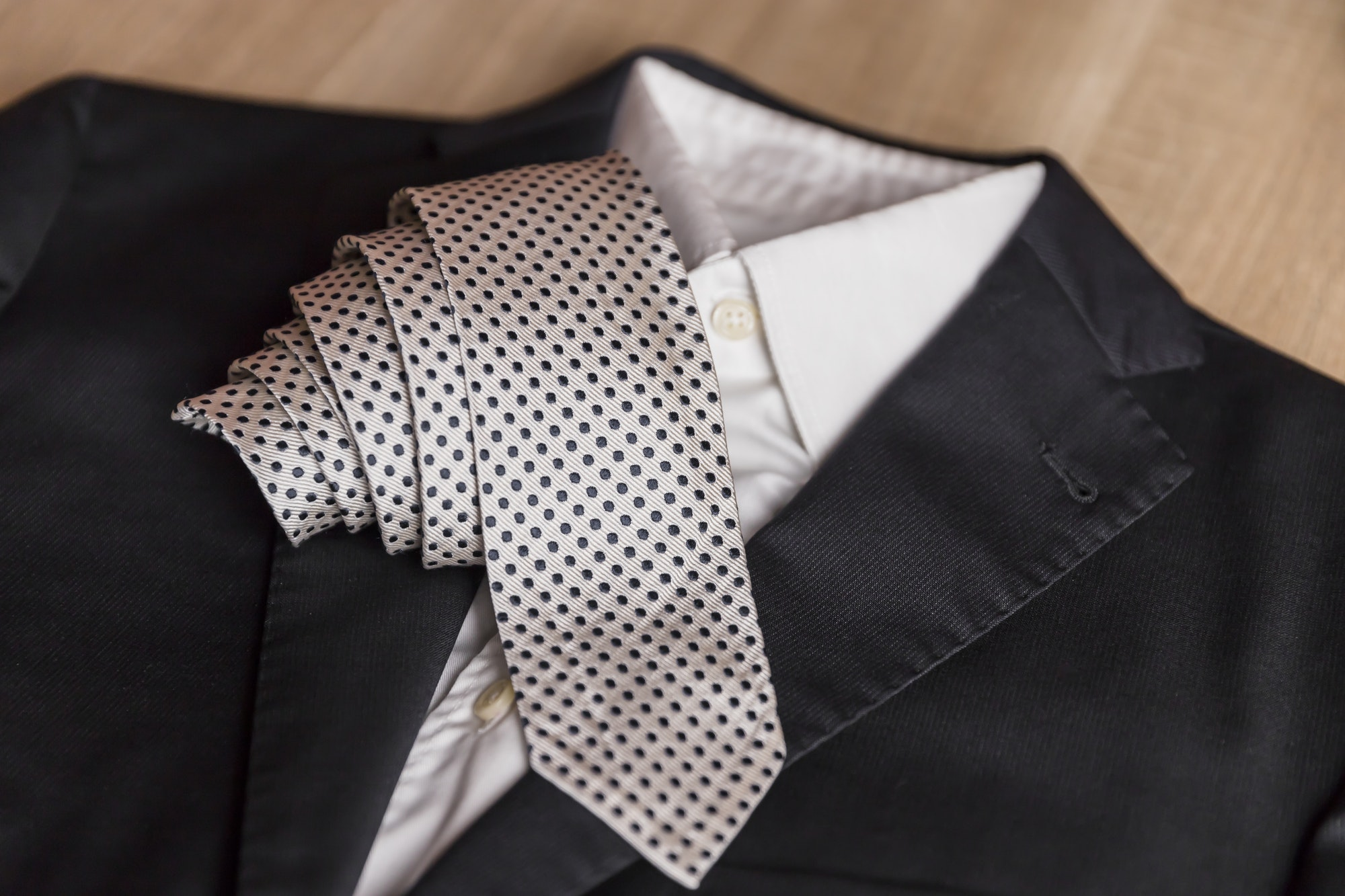 Jacket and tie detail. concept of Italian tailoring. Quality, style, made in Italy.
